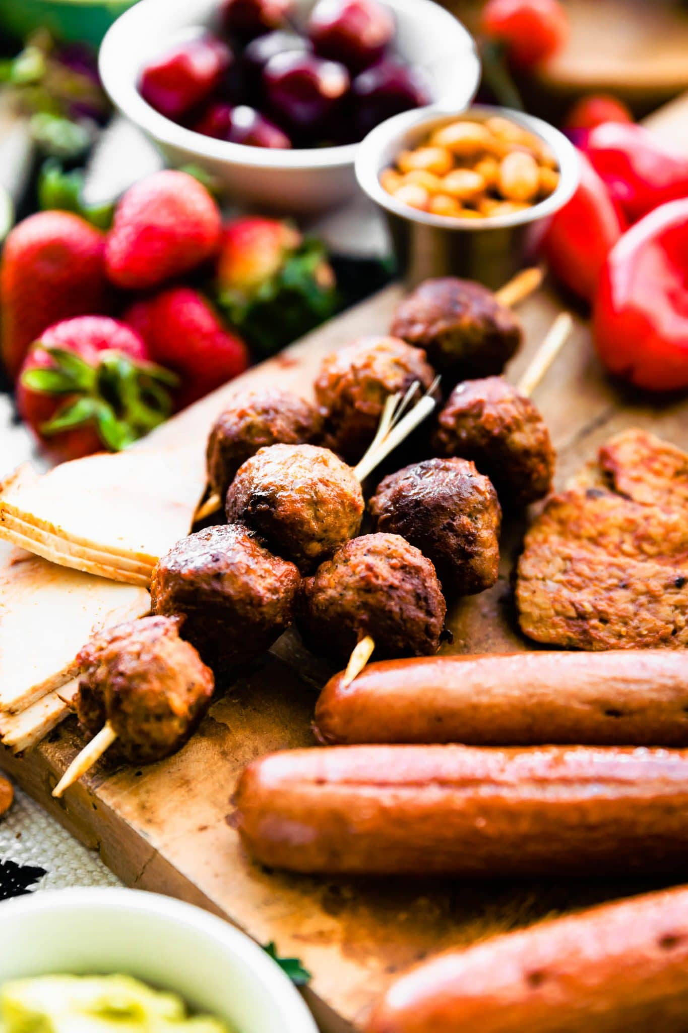Close up image of recipes included in the summer bbq graze board such as homemade meatball skewers