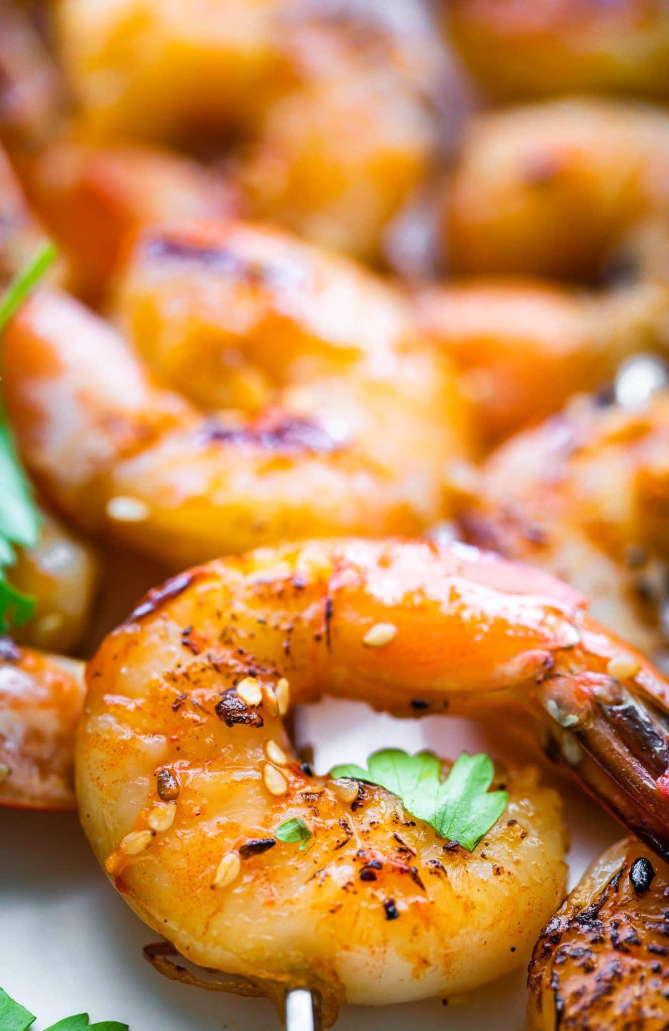 Close up image of marinated grilled shrimp.