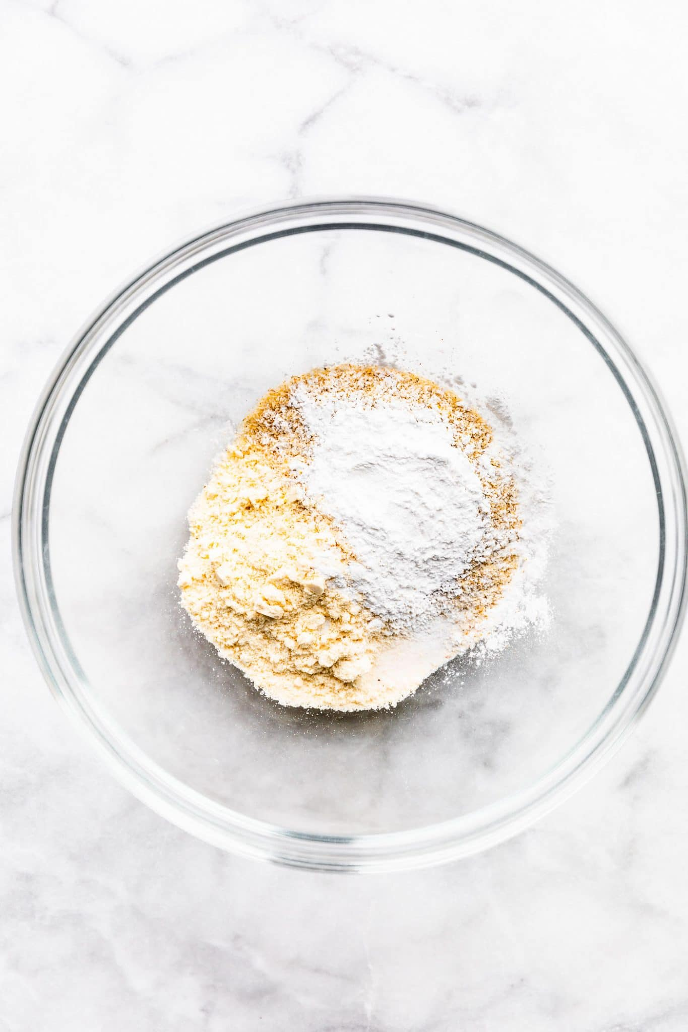 Overhead image of ingredients for coconut flour tortillas in a mixing bowl.