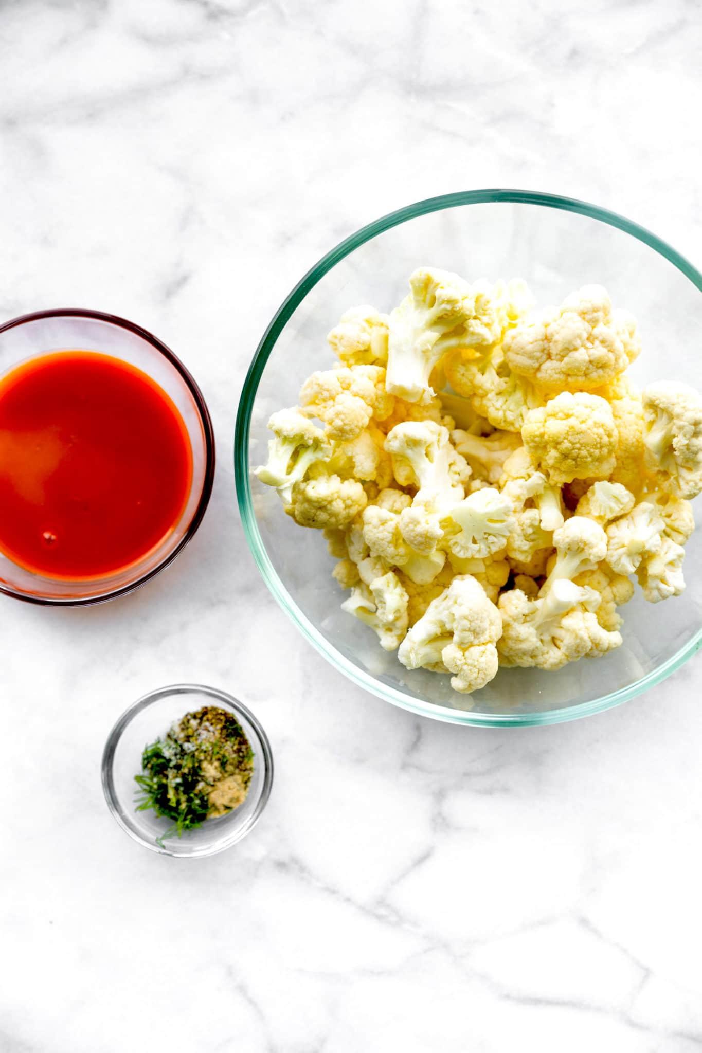 buffalo sauce, cauliflower florets, and seasonings