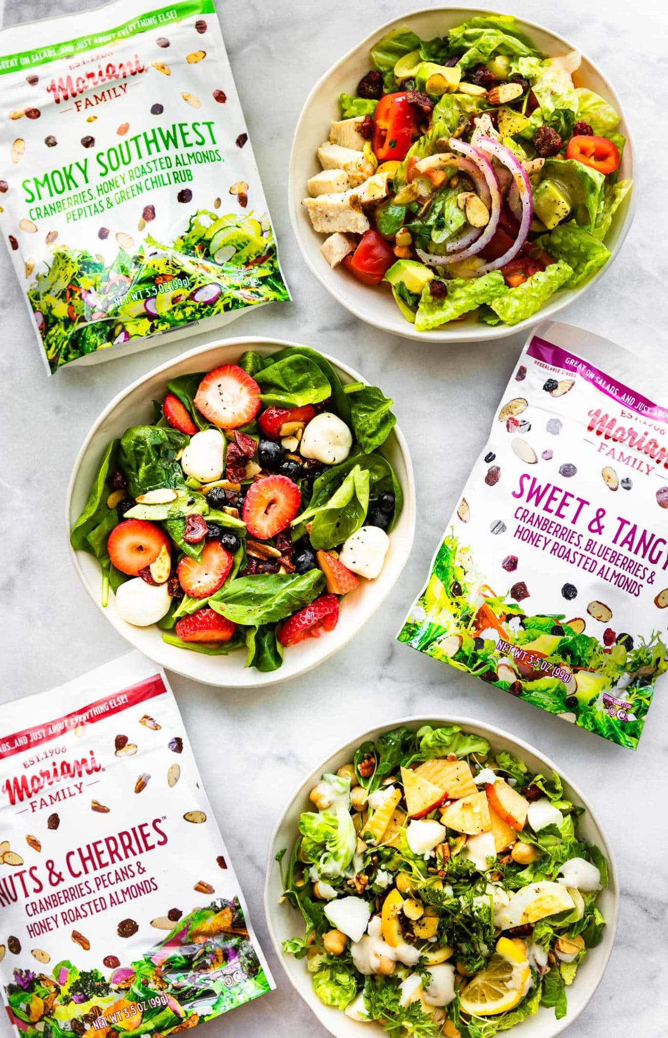 Overhead image of salad bowls and salad toppers