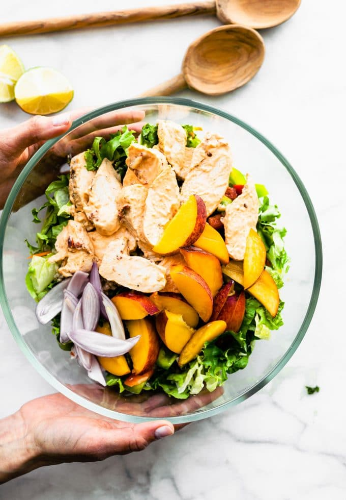 Overhead peach chipotle chicken salad in process