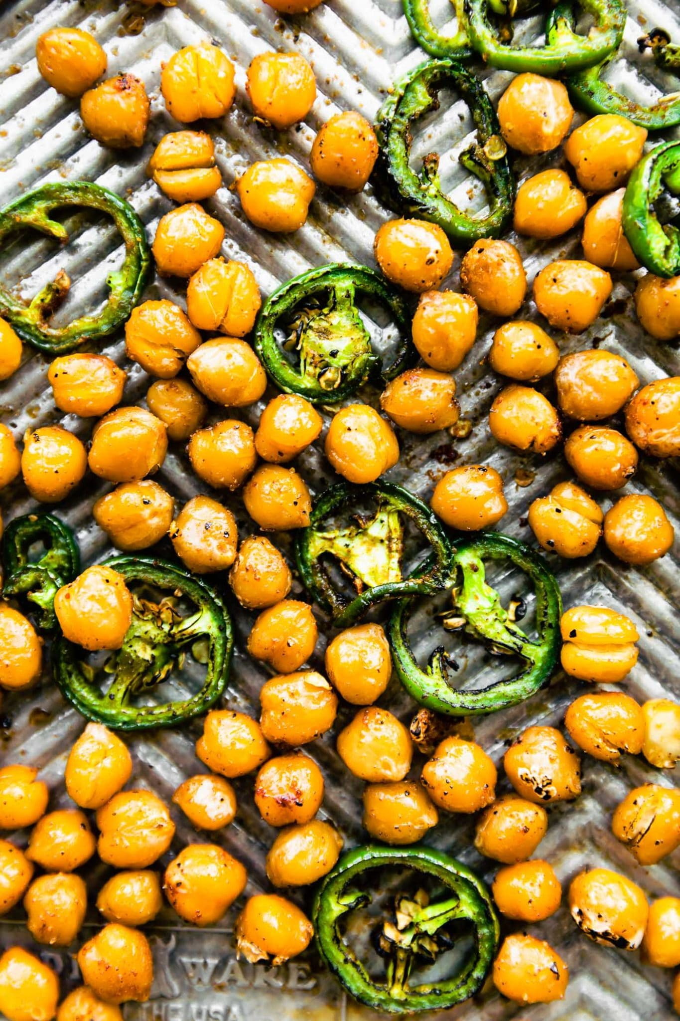 Roasted chickpeas and jalapeños on a baking sheet