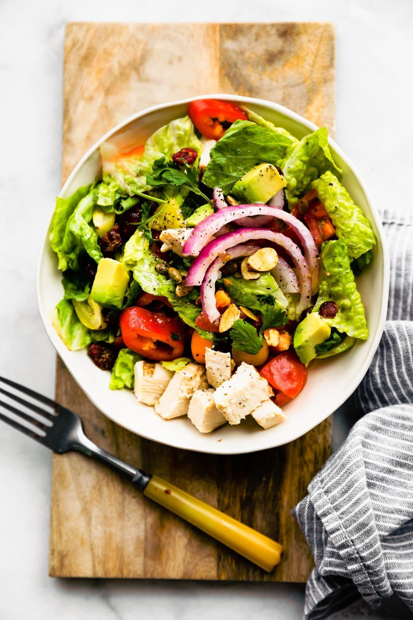 Overhead image of southwest chicken salad on a wooden serving platter.