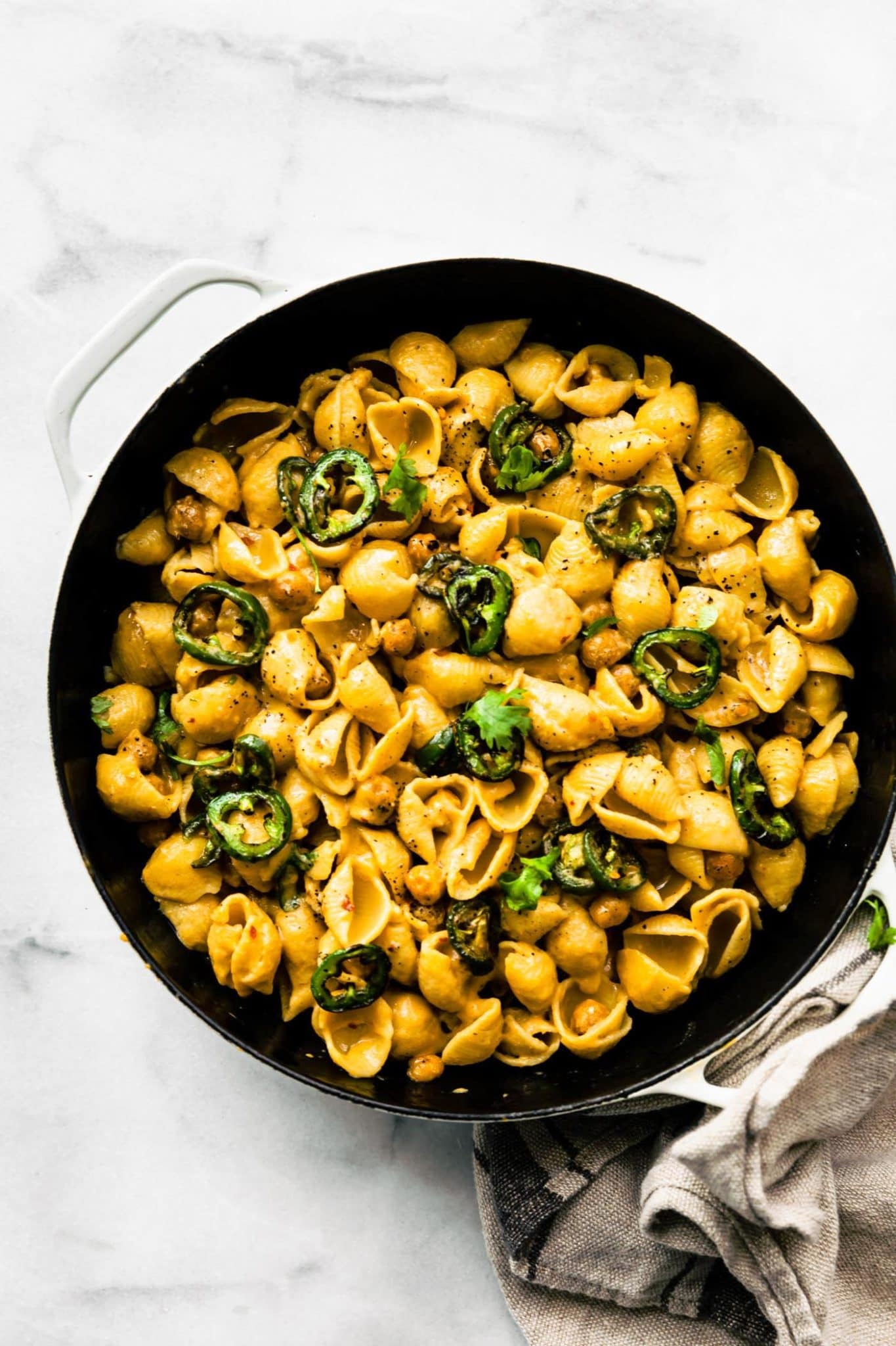 Vegan Jalapeño Chickpea Mac and Cheese in a skillet on a marble counter