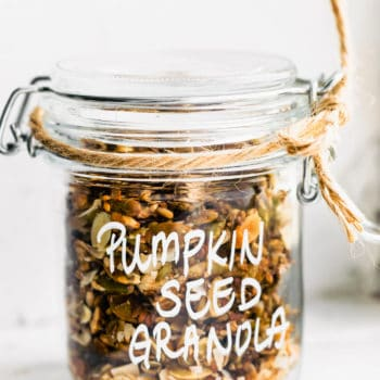 pumpkin seed granola in a jar with twine wrapped around the top