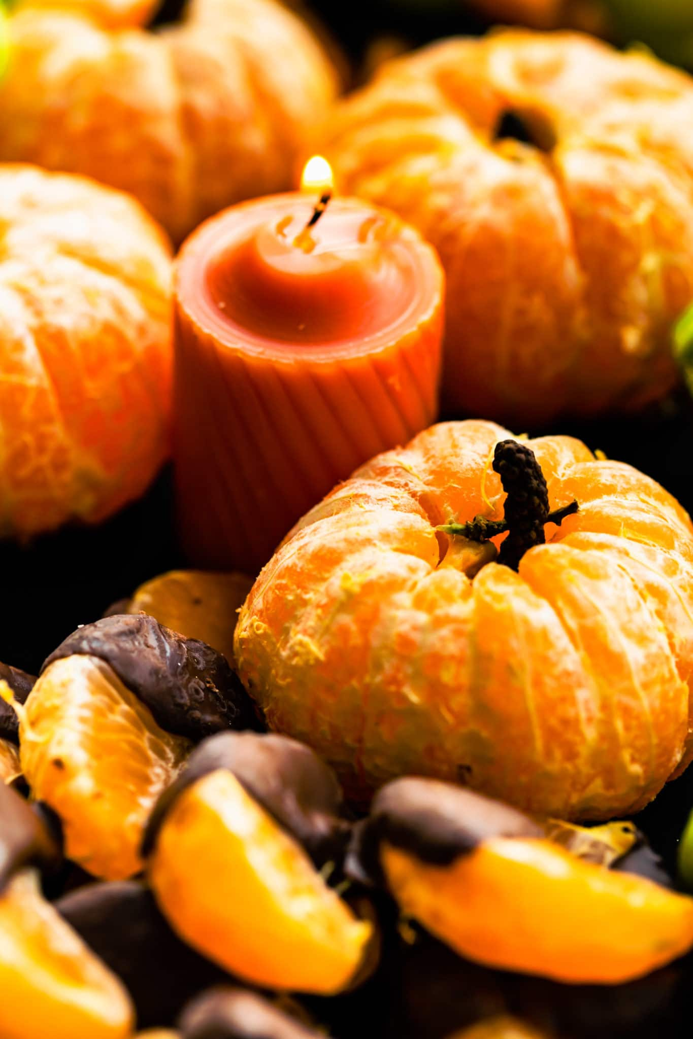 peeled oranges with peppercorn stems to resemble pumpkins and chocolate dipped orange slices