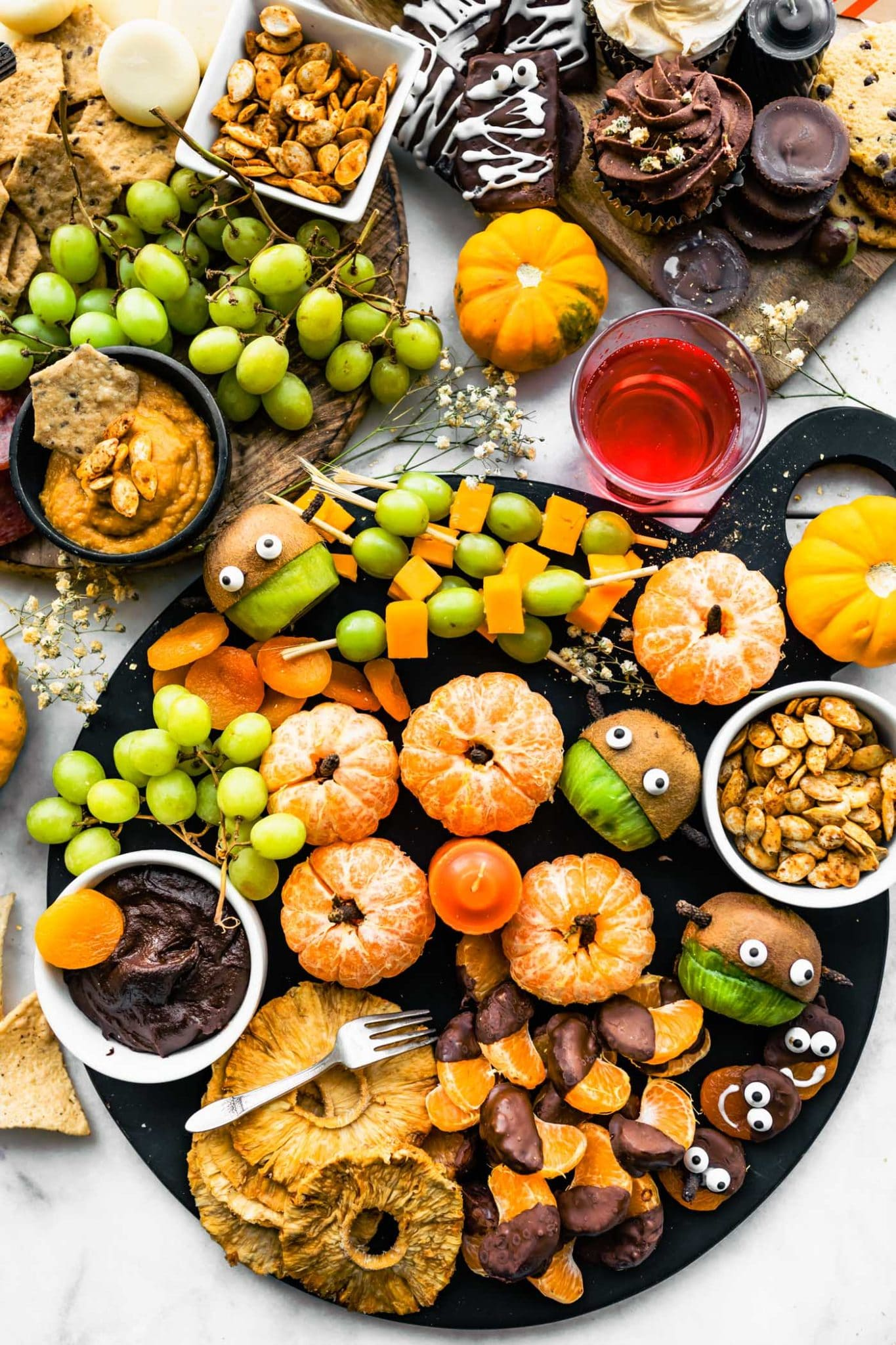 3 Halloween Charcuterie boards with fresh fruit, seeds, and healthy dips
