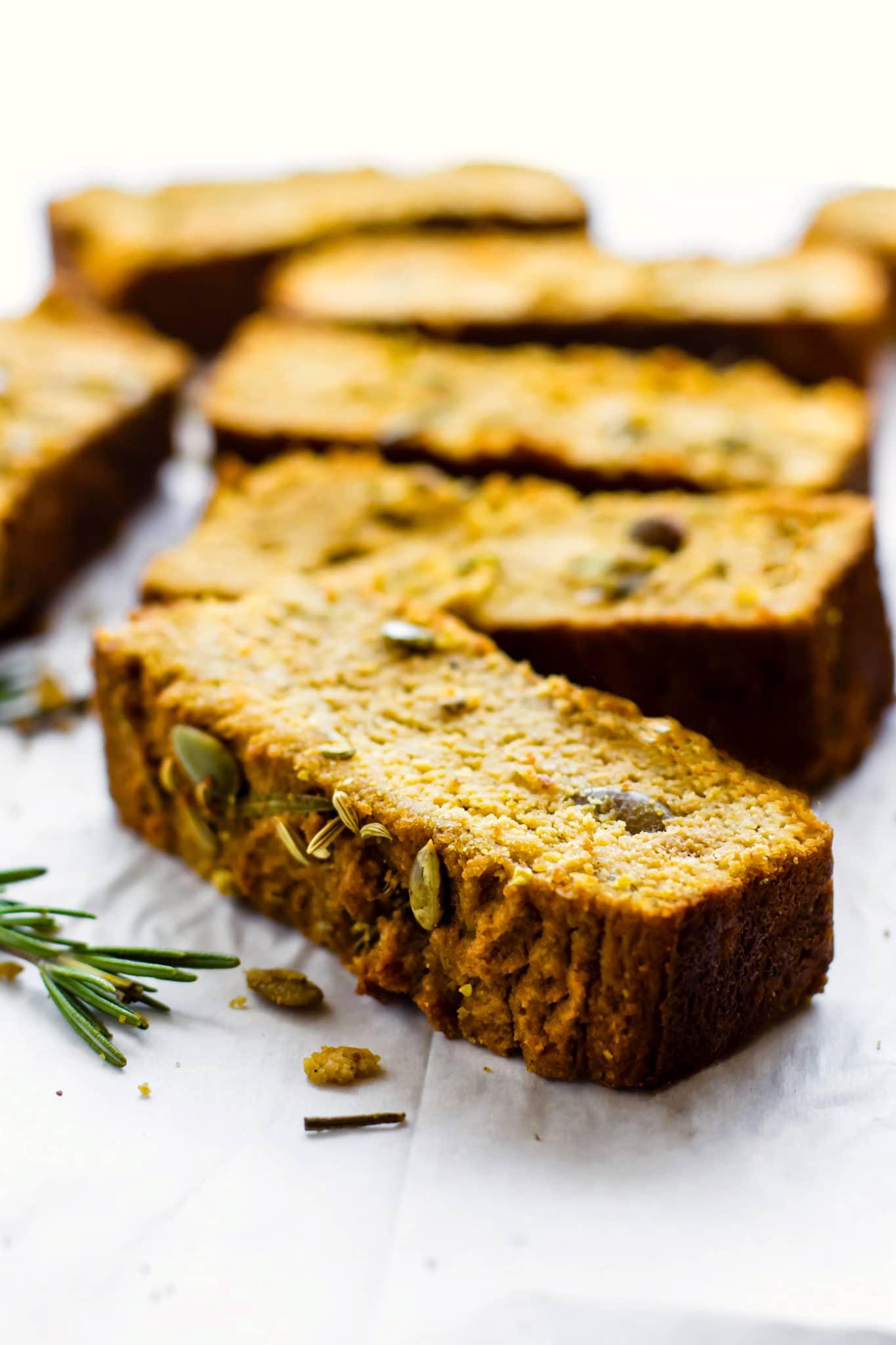 close up image of sliced pumpkin rosemary bread