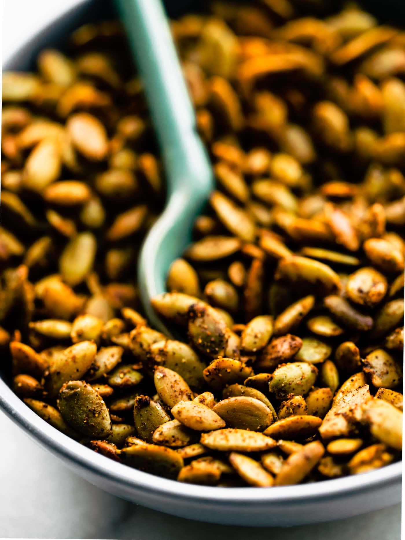 Close up image of seasoned and roasted pepitas