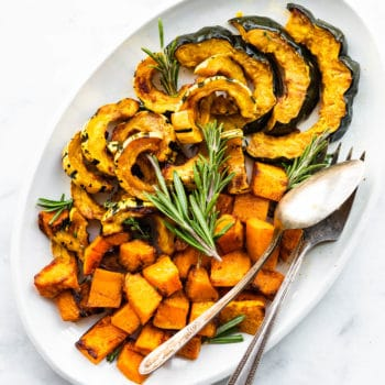 Roasted acorn, delicata, and butternut squash on a serving platter
